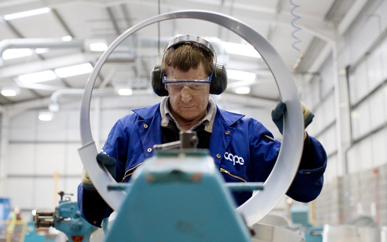 Cape employee operating machinery